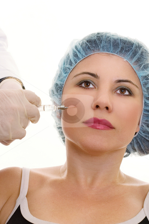 Collagen Injection stock photo, A woman receives a collagen or hyaluronic acid filler. by Leah-Anne Thompson
