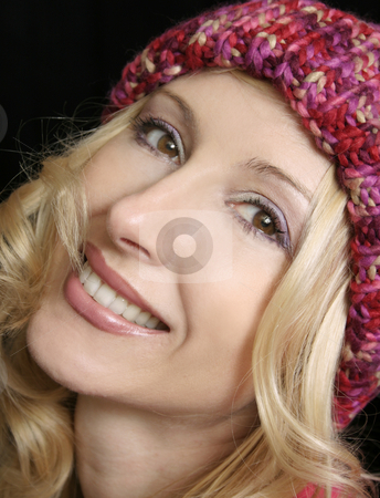 Happy Woman stock photo, Happy woman smiling woman in winter beanie by Leah-Anne Thompson