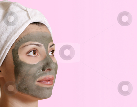 Female in clay beauty mask stock photo, Female with a clay mask and space for  message. by Leah-Anne Thompson