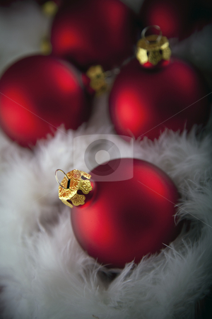 Christmas decorations stock photo, Red christmas baubles by Portokalis