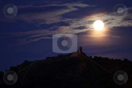 Full moon stock photo, A full moon is above a castle by ARPAD RADOCZY