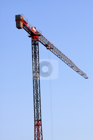 Crane stock photo, A tall crane high houses can be built by ARPAD RADOCZY