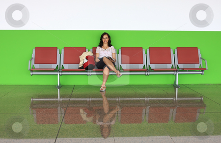 Young girl reading stock photo, Young girl   on the airport bench by ARPAD RADOCZY