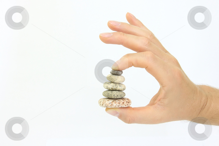Stone column stock photo, Isolated harmonious stone column holding hand by ARPAD RADOCZY