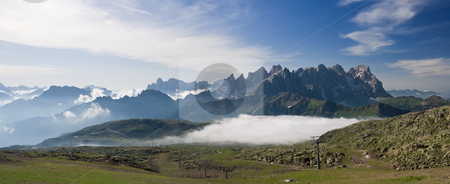 Pale San Martino at morning stock photo, Summer view of dolomites  mountain with cableway near San Pellegrino pass, Trentino, Italy. On the background Pale San Martino mountain. by ANTONIO SCARPI