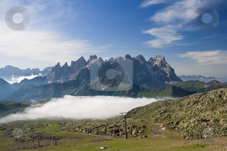 Morning in Dolomites stock photo, Summer view of dolomites  mountain with cableway near San Pellegrino pass, Trentino, Italy. On the background Pale San Martino mountain. by ANTONIO SCARPI