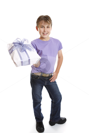 Young boy holding present stock photo, A young boy dressed in jeans and t-shirt holds a present tied up with a big ribbon ow. by Leah-Anne Thompson