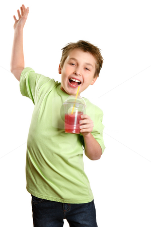 Jumping child holding healthy fruit juice stock photo, A boy jumps in delight.   He is holding a healthy fruit juice and smiling with glee. by Leah-Anne Thompson