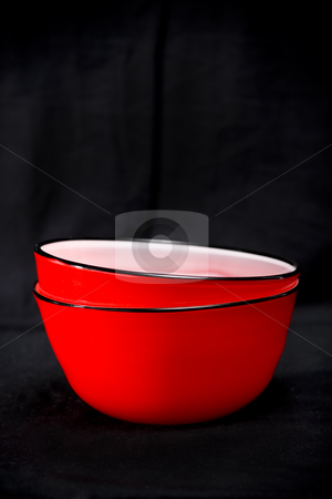 Red bowls stock photo, Contemporary red bowls on a black background by Jodie Johnson