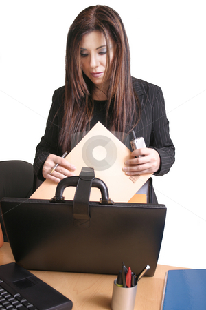 Client's file stock photo, A businesswoman getting a file out of her briefcase by Leah-Anne Thompson