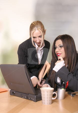 Business Solutions stock photo, Two colleagues work and discuss business matters by Leah-Anne Thompson