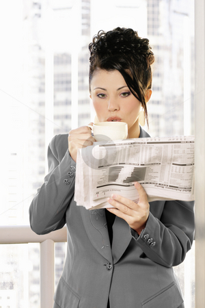 Business coffee break stock photo, Businesswoman enjoys coffee and newsbreak by Leah-Anne Thompson