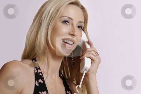 Aloha - Friendly smiling girl answering telephone stock photo, Friendly girl greeting a caller with a happy smile by Leah-Anne Thompson
