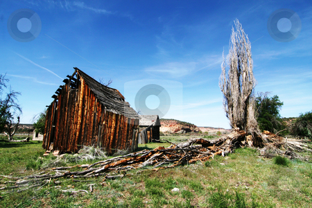 Americana stock photo, Old  Barn in the desert with redrock in the background by Mark Smith