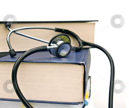 Books and stethoscope stock photo, Studying medicine or research book with stethoscope on white by Phil Morley