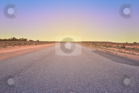 Driving into the sunset stock photo, Long road going into the sunset or the sunrise by Phil Morley