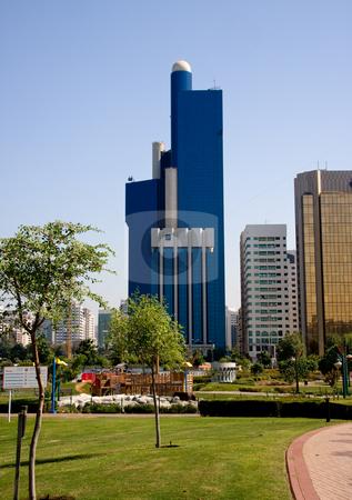 Vertical Abu Dhabi skyline stock photo, Vertical format of blue office building in Abu Dhabi in UAE by Steven Heap