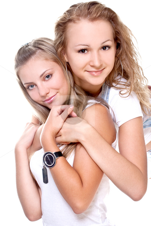 Two beautiful women in a white T-shirts  stock photo, Two beautiful women in a white T-shirts on a white background isolated by Artem Zamula