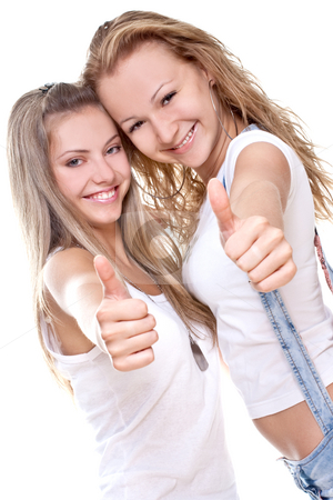 Two beautiful women in a white T-shirts giving thumbs-up   stock photo, Two beautiful women in a white T-shirts giving thumbs-up on a white background by Artem Zamula