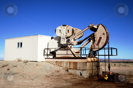Oil Well stock photo, Oil well with spilled oil and blue sky's by Mark Smith