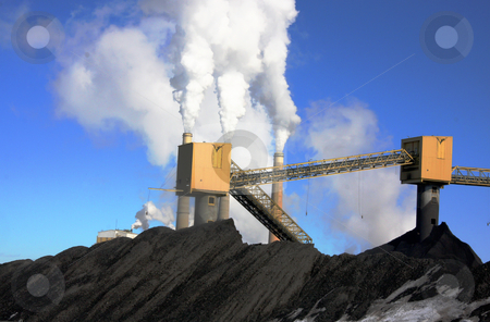 Power Plant stock photo, Power pland emitting smoke with blue sky's  and coak in the forground by Mark Smith