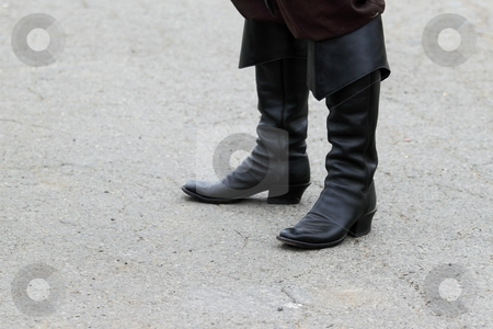 Black Boots stock photo, Someone standing in old mideaval black boots by Henrik Lehnerer