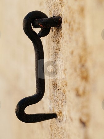 Metal hook stock photo, Metal hook on vintage wall with selective focus by Laurent Dambies