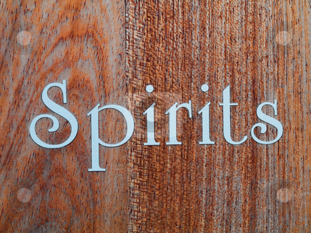 Spirits stock photo, Spirits  in white letter written on wood panel by Laurent Dambies