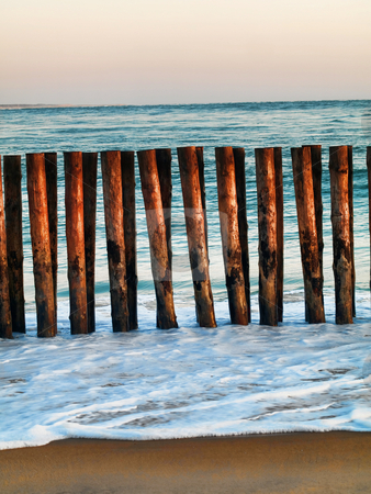 Beach  shore stock photo, Atlantic ocean beach shore with wooden barrier by Laurent Dambies
