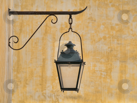 Vintage lamp stock photo, Wall mounted vintage lamp with yellow background by Laurent Dambies