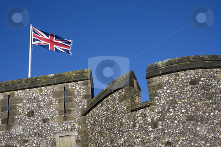 Union flag flying stock photo, British flag flying above a castle wall by Darren Pattterson