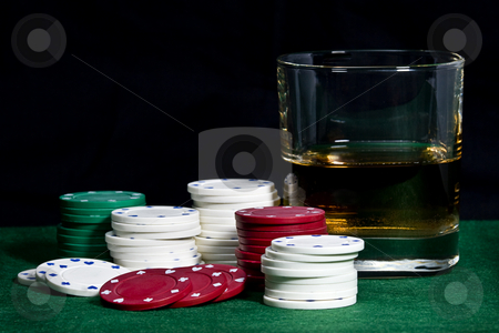Casino chips with whisky glass stock photo, Poker chips and a drink on green felt with a black background by Jodie Johnson