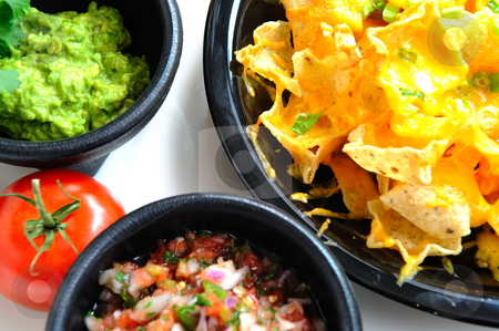 Nachos and Toppings stock photo, Top view of cheese Nachos with tomato salsa and fresh guacamole by Lynn Bendickson