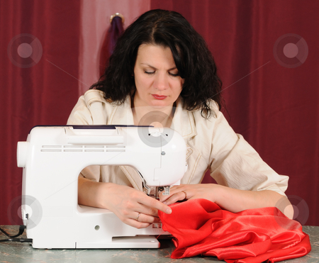 Sewing  stock photo, To sew a  material on the sewing machine by Salauyou Yury