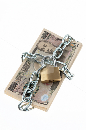 Locked Japanese Currency stock photo, Japanese currency with chain and lock. Vertically framed shot. by Erwin Johann Wodicka