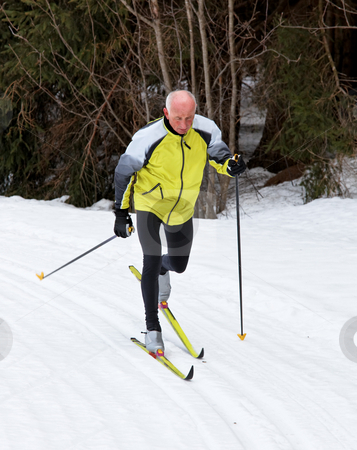 Senior Male Cross Country Skiing stock photo, Senior male cross country skiing. Vertically framed shot by Erwin Johann Wodicka
