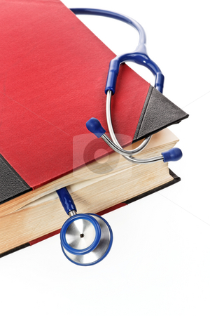 Stethoscope in Book stock photo, Stethoscope in book. Vertically framed shot. by Erwin Johann Wodicka