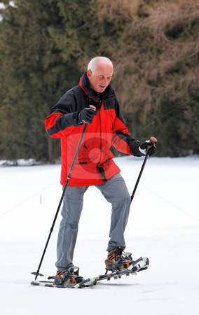 Senior Man Snowshoeing stock photo, Senior man snowshoeing. Vertically framed shot. by Erwin Johann Wodicka