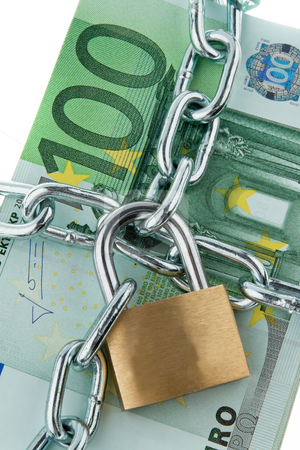 Locked European Currency stock photo, European currency with chain and lock. Vertically framed shot. by Erwin Johann Wodicka