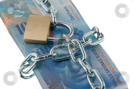 Locked Swiss Currency stock photo, Swiss currency with chain and lock. Horizontally framed shot. by Erwin Johann Wodicka