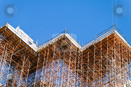 Building under construction stock photo, Concrete formwork and scaffolding on a construction site. Horizontally framed shot. by Erwin Johann Wodicka