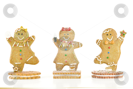 Three Gingerbread Cookies stock photo, Three glittery holiday gingerbread cookies isolated on white background. by Tammy Abrego