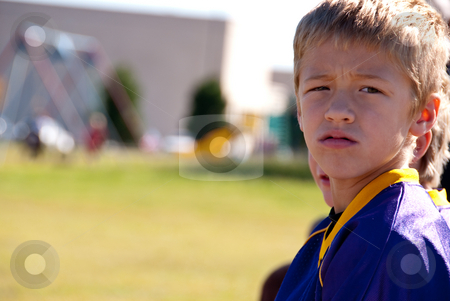 Boy Athlete stock photo, Boy football player looking at the game. by Tammy Abrego