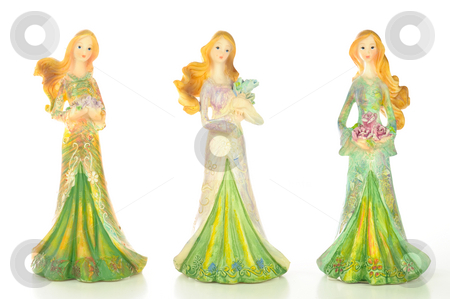 Three Pretty Ladies stock photo, Three pretty lady statues all dressed up and holding flowers; isolated on white background. by Tammy Abrego