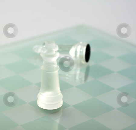 Winner stock photo, Solitary king of chess of glass winning over another glass king by Fabio Alcini