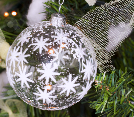 Christmas ball stock photo, White glass Christmas ball shot in a tree by Fabio Alcini