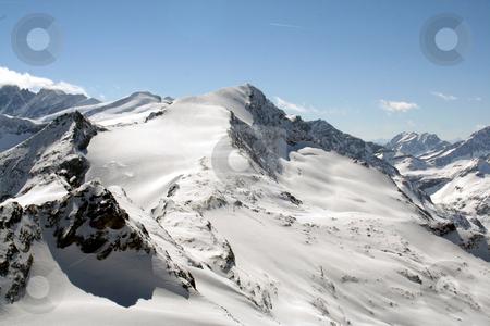 Alpine landscape stock photo, Scenic view of snow capped Alpine mountain range, Switzerland. by Martin Crowdy