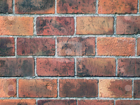 Brick wall background stock photo, Seamless weathered red brick wall background. by Martin Crowdy