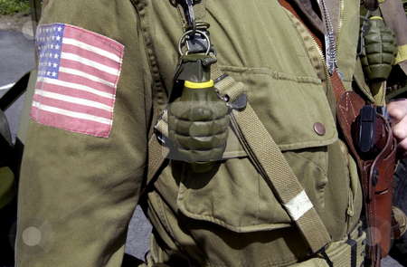 American world war two GI soldier stock photo, Details of American World War two GI soldier wearing army uniform with hand grenades and pistol. by Martin Crowdy