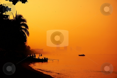 Sunset on the beach. stock photo, Amazing beach with mysterious sunset light. by Oleg Blazhyievskyi